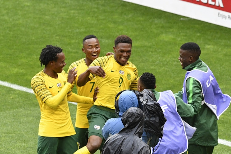 Lebo Mothiba of South Africa celebrates scoring a goal with Percy Tau during the 2019 Africa Cup of Nations qualification match between South Africa and Seychelles at FNB Stadium on October 13, 2018 in Johannesburg, South Africa.