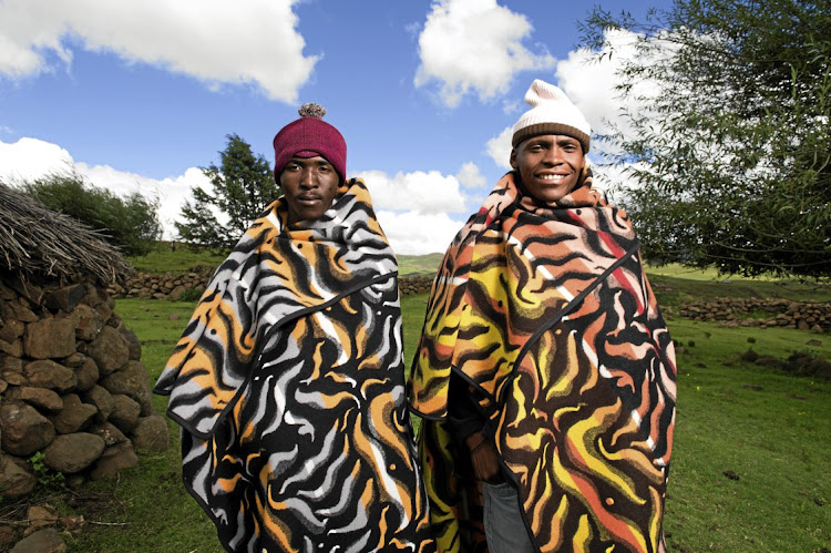 Two men who went for the Malakabe (flame) design. The blankets worn by Basotho are moving with the times, and are promoted to young people through the royal fashion fair ever year in Lesotho.