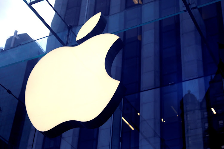 FILE PHOTO: The Apple Inc. logo is seen hanging at the entrance to the Apple store on 5th Avenue in Manhattan, New York, U.S., October 16, 2019.