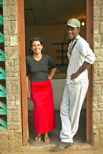 A Cuban woman and man in a doorway.