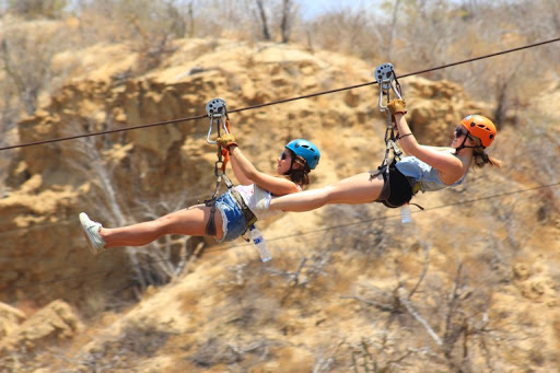 Tandem ziplining with a friend across Wild Canyon in Baja California.