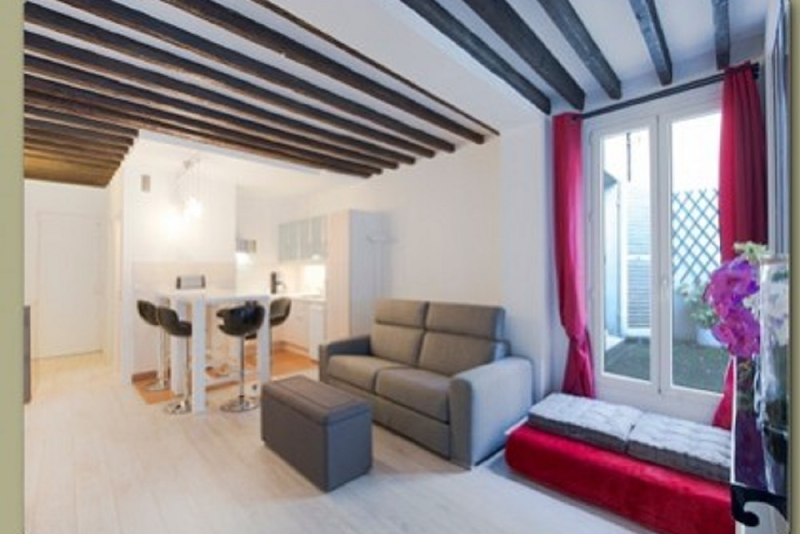 Living area at 1 Bedroom Apartment Near Place des Vosges