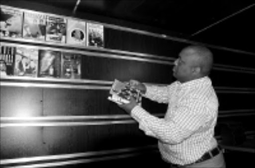 07/10/2008. VRU. Oupa Moloi from RISA (Recording Industry of SA) holding a fake DVD of Shongwe & Khuphuka saved group. The fake DVD's were confiscated from a video shop at Bruma Lake. PHOTO: VATHISWA RUSELO