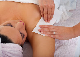 a lady having her underarm waxed