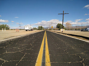 Photo: Kelso-Cima Rd. The Mojave is full of these small roads and it's a real joy to drive through them. You can drive for a long time without seeing a person or another car. The asphalt has a quality that makes it show burgundy or black, depending on the sun's position.