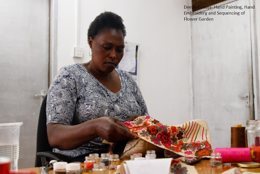Deepa Dosaja's artisan embroidering the bodice of the dress