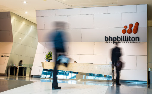People walk through the foyer of the BHP Billiton headquarters in Melbourne, Australia. Picture: BLOOMBERG