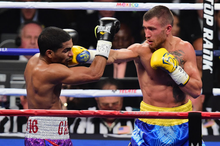 Vasyl Lomachenko (blue/yellow trunks) and Gamalier Rodriguez (purple trunks) box during their WBO featherweight championship bout at the MGM Grand Garden Arena, in Las Vegas, Nevada, in the US Picture: USA TODAY/JOE CAMPOREALE