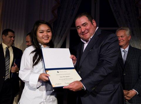 Photo: Tran Nguyen receiving her award from Emeril Lagasse