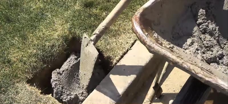 Installazione recinzione con cemento