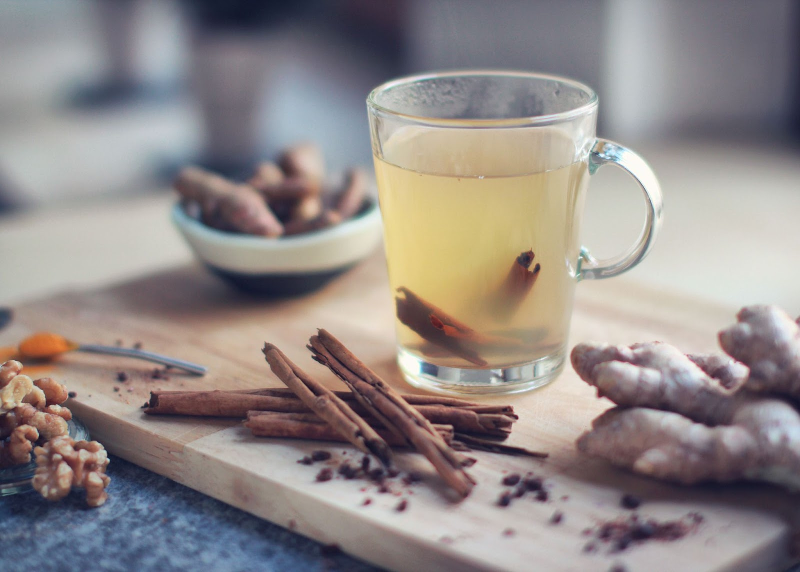 A glass cup filled with cinnamon tea for candida.