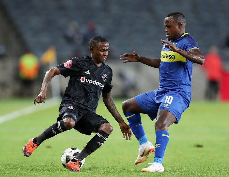 Thembinkosi Lorch of Orlando Pirates challenged by Ayanda Patosi of Cape Town City during the Absa Premiership 2018/19 match between Orlando Pirates and Cape Town City at the Orlando Stadium, Soweto on 19 September 2018.