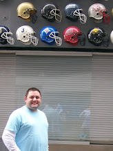 Photo: Me standing near the WHHS helmet at the big wall of all of the high school teams in the Carolinas!