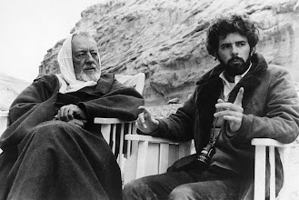 Photo: Original caption: 7/5/1977-New York, NY- Director George Lucas(right) and Alec Guinness as Ben Kenobi discuss Kenobi's mysterious appearance in the desert from the film