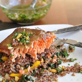 Wild Salmon with Quinoa, Dandelion Greens and Parsley Pistachio Vinaigrette.