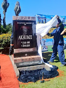 The headstone of the late actor Akhumzile Jezile marks his final resting place. It was designed by the Bataung funeral home.