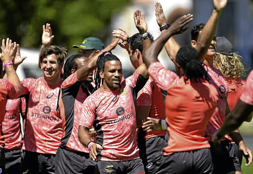 Fives high: Rosko Specman, centre, and Kwagga Smith, left, celebrate with their Blitzboks teammates after a training session ahead of this weekend's tournament in Cape Town. Picture: ASHLEY VLOTMAN/GALLO IMAGES