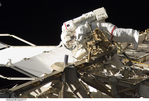 Astronauts Dave Wolf kicks off new work on the International Space Station with the first of five space walks.