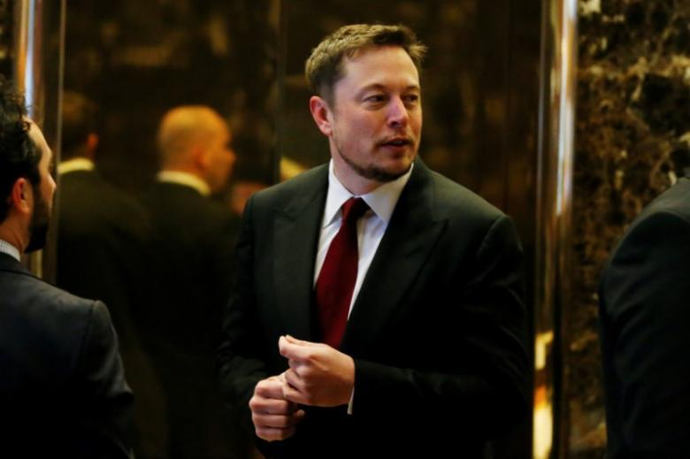 Image result for Tesla Chief Executive, Elon Musk enters the lobby of Trump Tower in Manhattan, New York, U.S., January 6, 2017