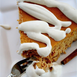 Spiced Pumpkin Cheesecake with Brown Sugar Bourbon Cream