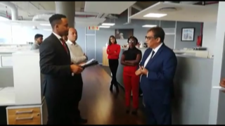 In a screengrab from a video posted on the Business Report website, businessman Iqbal Survé can be seen speaking to an official from the financial regulator at his Cape Town offices on Wednesday morning.