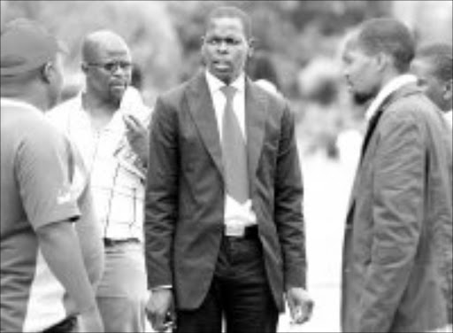 AGGRIEVED: Alex Mthiyane, centre, and Sthembiso Shagase, right, with  friends outside court yesterday. Pic. Mandla Mkhize. 15/01/2007. © Sowetan.