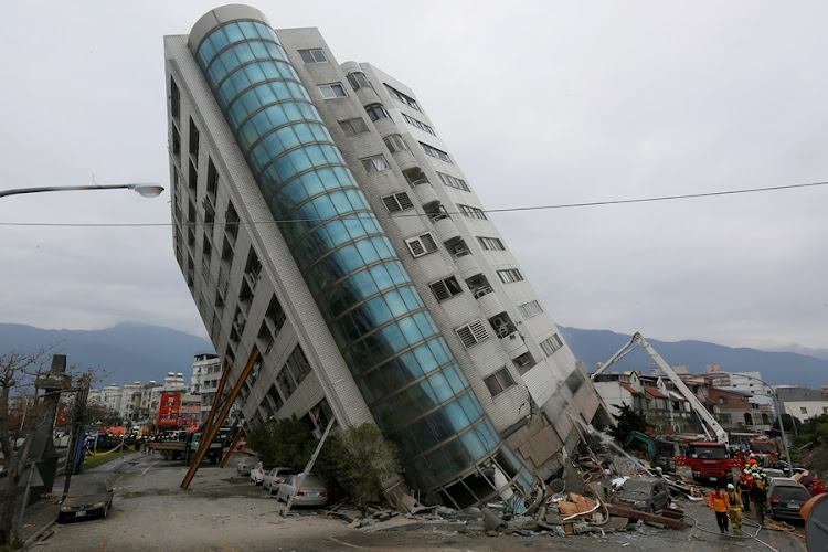 Rescue workers are seen by a damaged building after an earthquake hit Hualien, Taiwan February 7, 2018. File photo