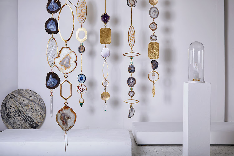 Geré Victor's upsized and sculptural Adorn pendants made with a combination of garnets, jade, crystals, coral and more.