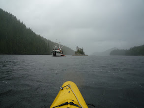 Photo: Kayaking in the rain is no problem at all, but it's always wonderful to come back to the ship.  Photo by Ben.