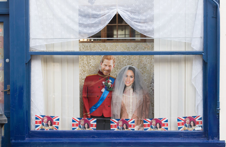 Royal wedding decorations hang in a shop window on May 17 2018 in Windsor, England.