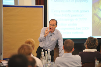 Photo: Futurist keynote speaker Patrick Dixon on platform giving keynote at corporate seminar on future industry trends