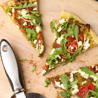 Pesto Pizza with Goat Cheese, Tomatoes and Arugula.