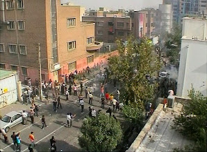 """Photo: ** CORRECTING DATE TO SATURDAY **In this image taken from amateur video posted online from Tehran, Saturday, June 20, 2009, shows supporters of opposition leader Mir Hossien Mousavi protesting in Tehran . Eyewitnesses described fierce clashes after some 3,000 protesters, many wearing black, chanted """"Death to the dictator!"""" and """"Death to dictatorship!"""" near Revolution Square in downtown Tehran. Police fired tear gas, water cannons and guns but it was not clear if they were firing live ammunition. (AP Photo/APTN/amateur video) ** Editorial use only **   Original Filename: CORRECTION_Iran_Elections_LON105.jpg"""