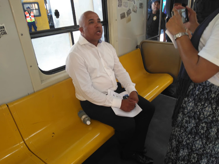 Western Cape head of Metrorail Richard Walker takes a train ride with the rail enforcement unit