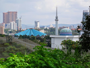 Photo: The fan roof is the National Mosque. In the lower left you can see the netting used for the Bird Park. The tall brown towers (Times Square) upper left is close to the apartment.