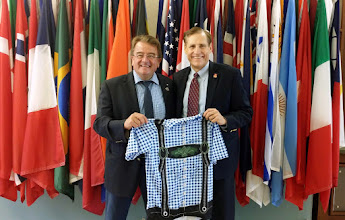 Photo: Presenting the signed Alpine Style Cycling Jersey in front of the International Rotary Flags