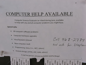 """Photo: Day 4: Amusing Ad at the Lopez Village grocery store billboard. """"Will solve *all* software problems"""". Right."""