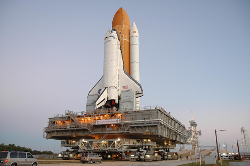 Space Shuttle Discovery on top of the mobile launcher platform and crawler-transporter approaches the ramp.