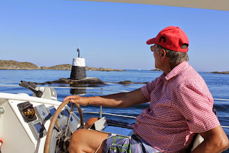 Photo: Frode at the helm. This type of navigational marker is known as a baake.
