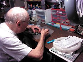 Photo: repairing model train set