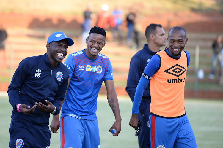 SuperSport United midfielder Aubrey Modiba (L), Sipho Mbule (C) and Thabo Mnyamane share a good laughing moment after their 3-0 MTN8 thrashing of Bidvest Wits.