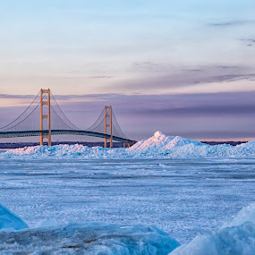 Sunset over the Mighty Mac  by Tammy Scott - Buildings & Architecture Bridges & Suspended Structures ( ice, sunset, frozen lake, architectural, architecture, bridge )