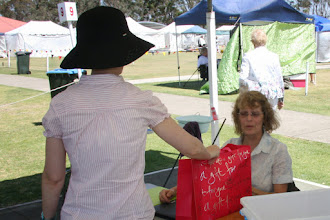 Photo: Jo Bartley our Dogs NSW Rep  being presented with a small gift by Marion Bollard.