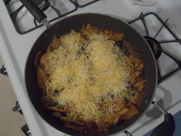 Add cheese & olives. Stir all together & heat til cheese is melted.  This is...