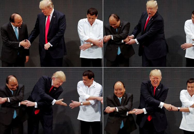 In a combination photo, US President Donald Trump registers his surprise as he realizes other leaders, including Vietnam's Prime Minister Nguyen Xuan Phuc and President of the Philippines Rodrigo Duterte, are crossing their arms for the traditional