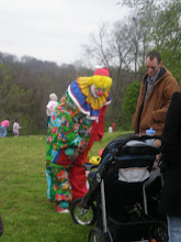 Photo: one of the clowns says hi to a baby