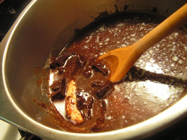 Place chocolate and butter in bowl of double boiler.  Set over simmering water,...