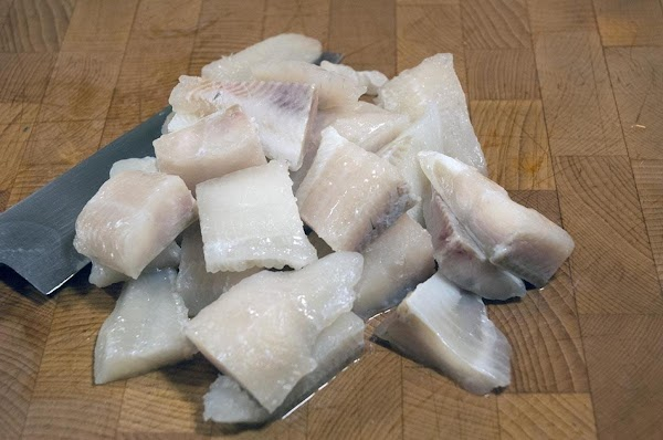 Cut the catfish into bite-sized pieces, and reserve.