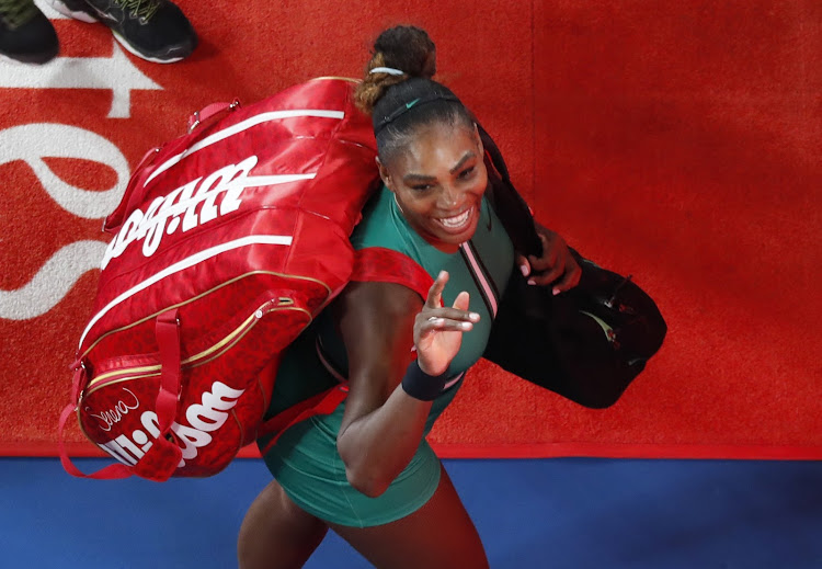 Serena Williams of the US celebrates after winning the match against Romania's Simona Halep.