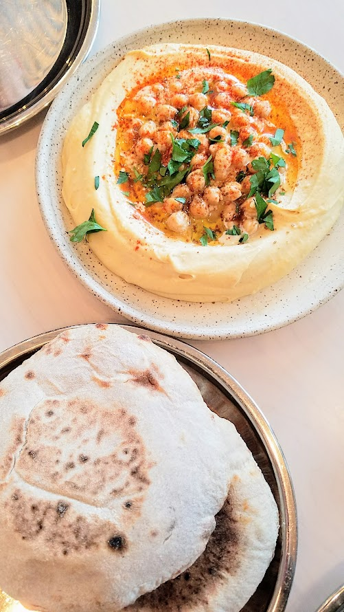 Tusk Portland, a large order of Hummus with paprika, parsley, served with Tusk flatbread